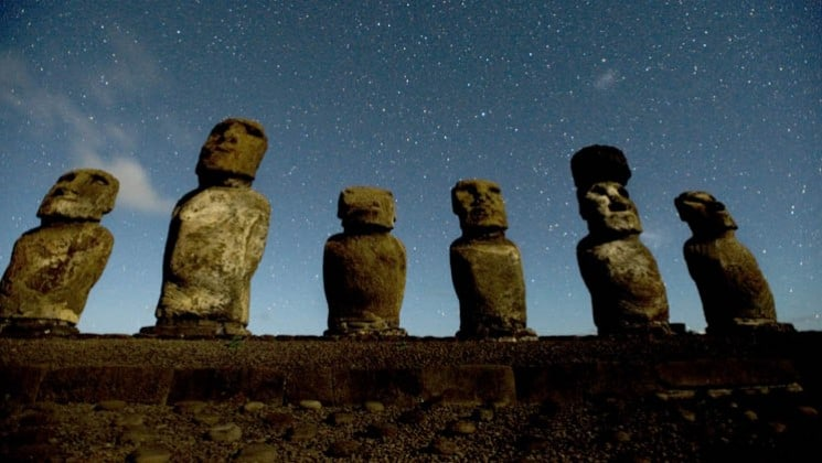 easter island head statues at night with stars visible on explora rapa nui land tour