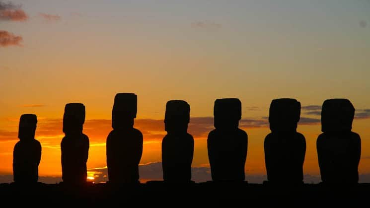 easter island statues at sunset on explora rapa nui land tour in chile