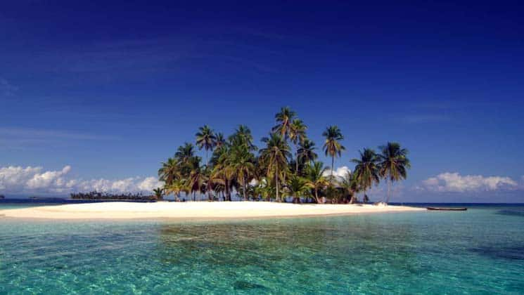A remote white-sand island with palm trees in Panama