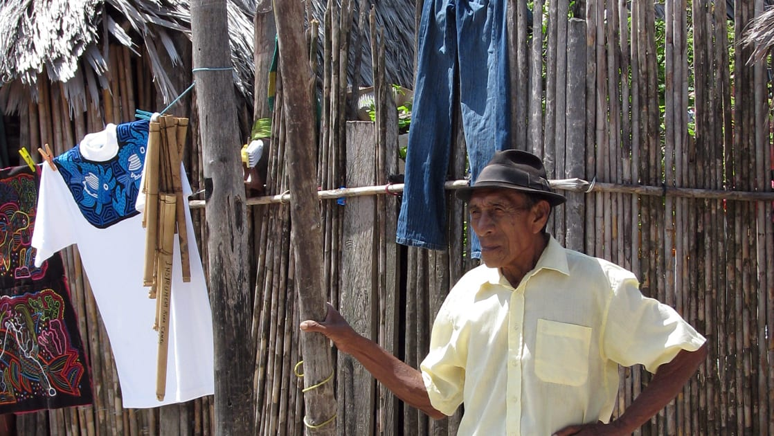 The chief of the Guna Yala people talking in front of a fence in Panama