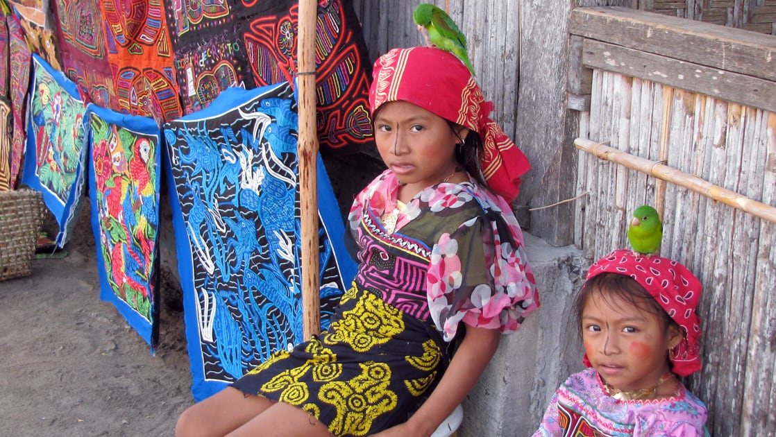 Two young girls in traditional outfits from the Guna Yala culture in Panama
