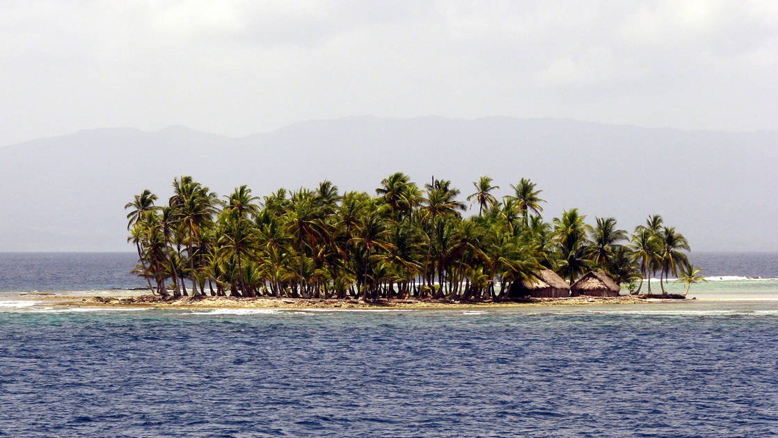 A remote island with trees and small huts in Pananma