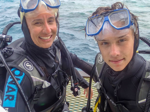 A mother and child about to SCUBA dive in the Great Barrier Reef