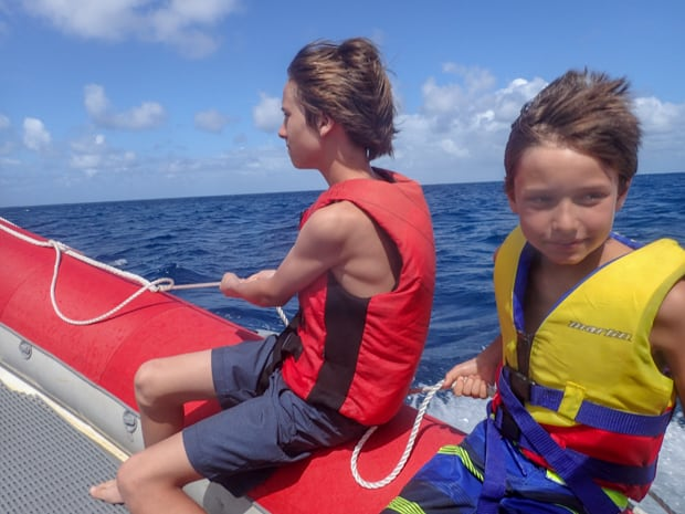 Two kids on an inflatable boat in Australia