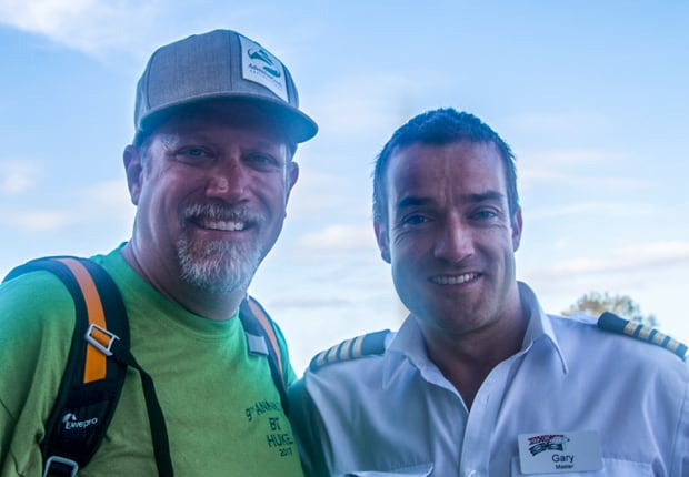 AdventureSmith founder Todd Smith interviewing Captain Gary Walsh on a Great Barrier Reef Australia small ship cruise.
