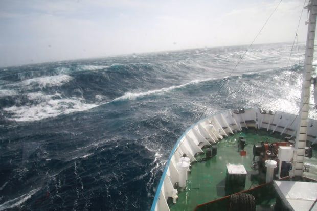 Small ship in rough waters crossing the Drake Passage to Antarctica.