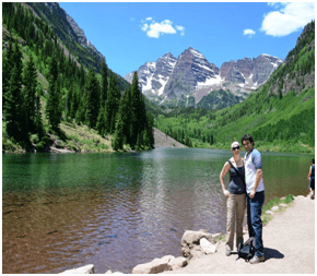 Photo of the Hawaii honeymooners hiking in the mountains at a lake