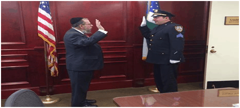Man in uniform taking an oath with another man.