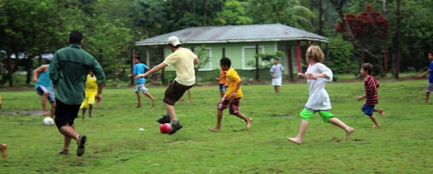 Playing soccer with the local Tortugero kids and Costa Rican travelers.