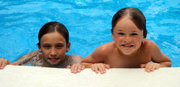Young travelers enjoying a day at the pool.