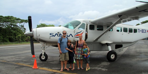 Family getting ready to embark on a small plane in Costa Rica.