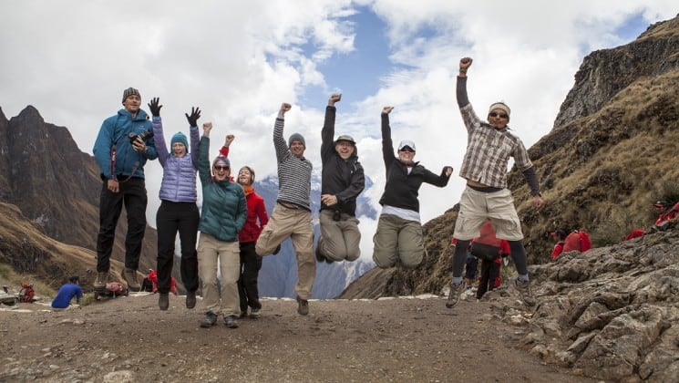 group shot with everyone jumping on inca trail trek land tour in peru