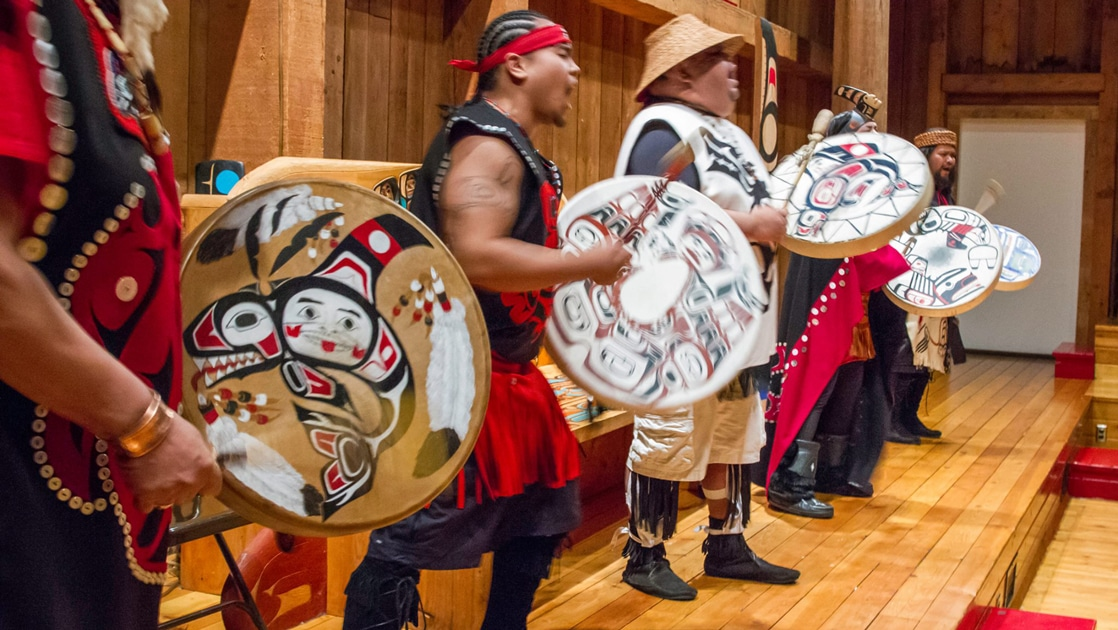 Men from the Metlakatla Indian Community on Annette Islands the only Indian Reserve in the State of Alaska dress in tribal garb and preform native Alaskan dance ritual.