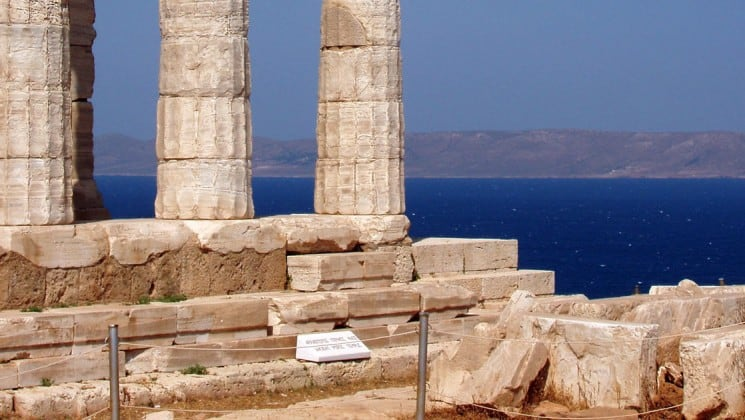 ancient greek ruins with columns and stones overlooking the aegean sea