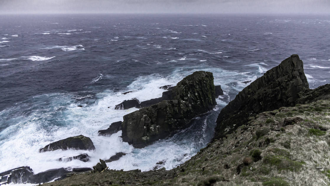 The ocean crashing against rocks off the coast of Lerwick in the Shetland Islands of Scotland