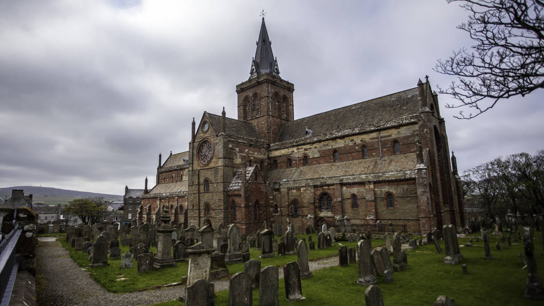 St. Magnus Cathedral in Kirkwall with a cemetery in front