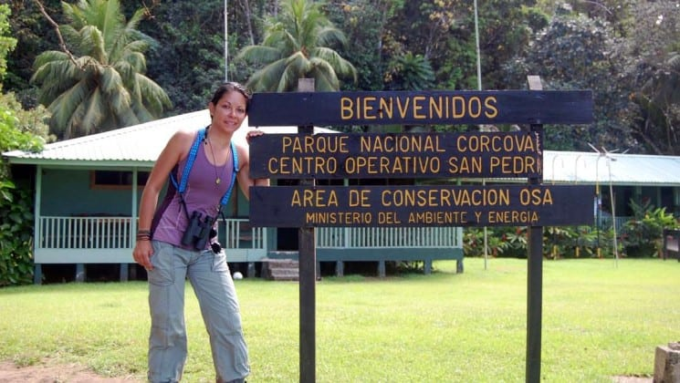 woman standing by corcova national park sign