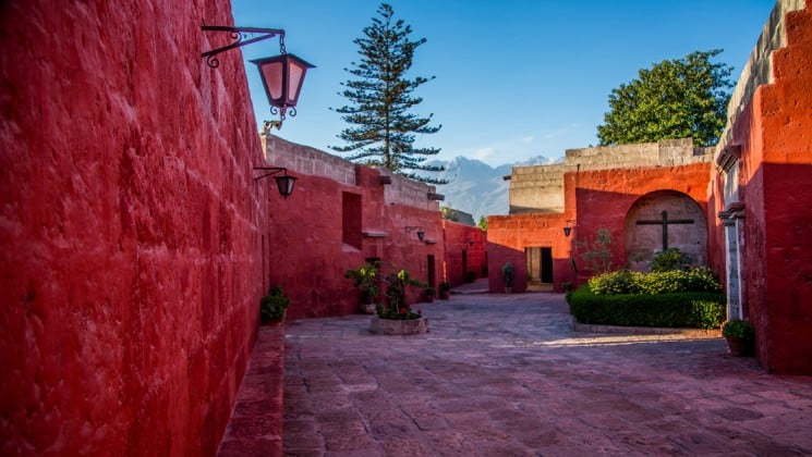 ancient red bricks comprise the walls and walkways at a monastery on peru highlights land tour