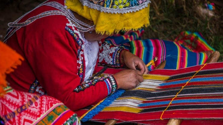 weaver concentrating on colorful project on peru highlights land tour