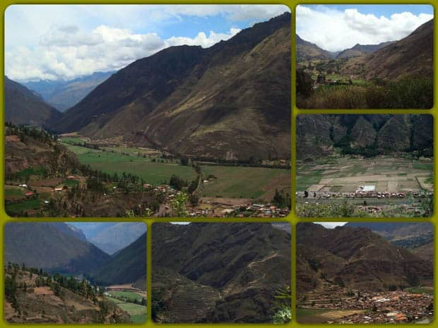 Sacred Valley with towering mountains and green grassy valley with villages in Peru.