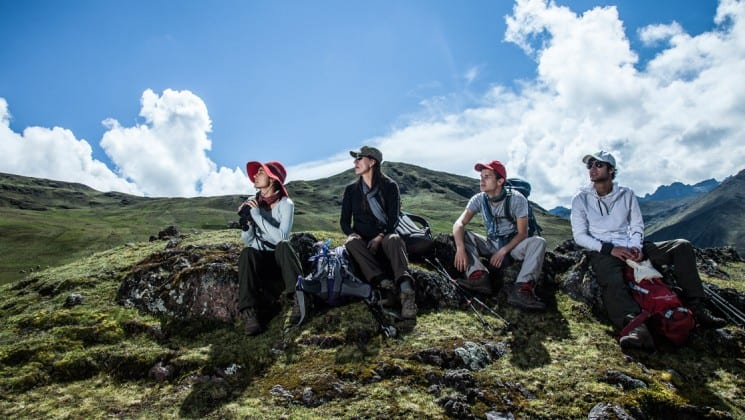 four trekkers in the mountains of peru sit and rest on sacred valley & lares adventure to machu picchu