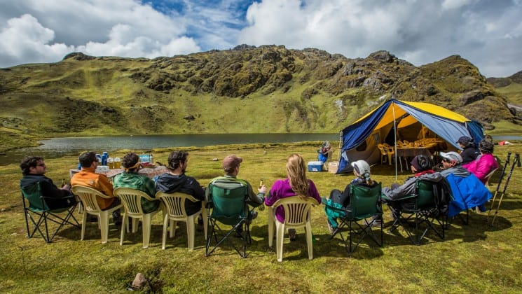trekkers picnic near a mountain pond on sacred valley & lares adventure to machu picchu land tour in peru