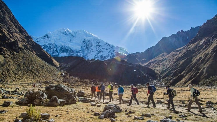 group of hikers in mountains on sunny day on salkantay trek to macchu picchu