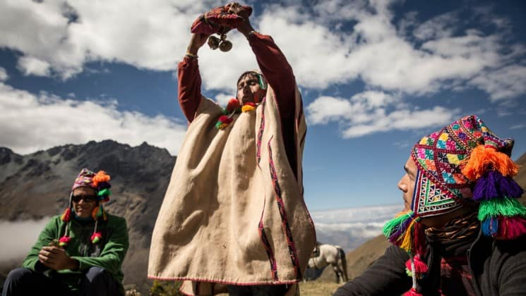 local spiritual leader performing blessing on salkantay trek to machu picchu
