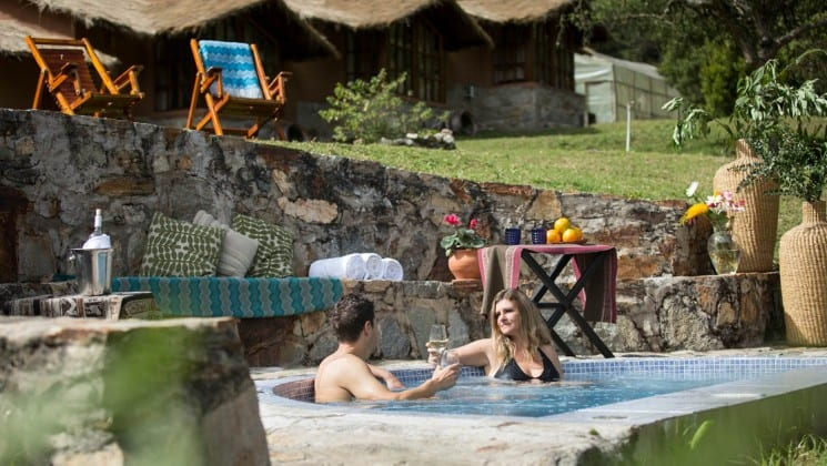man and woman in hot tub at lodge on salkantay trek to machu picchu in peru