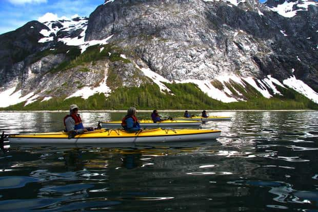 Guests from a small ship cruise on kayaking excursion from the Sea Wolf in Alaska.
