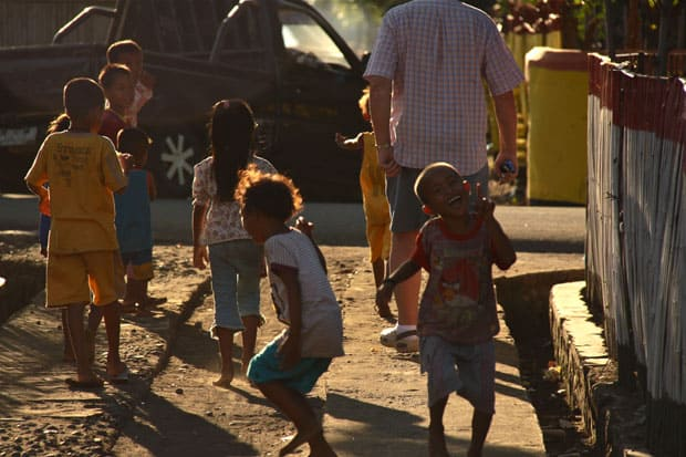 Group of happy small children playing on the street in a Indonesian town.