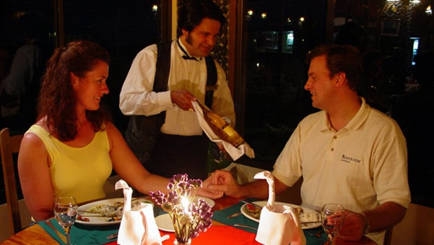A happy couple having dinner at a local Costa Rican restaurant.