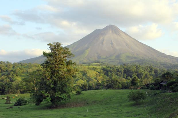 A scenic view of a volcano in Costa Rica with the rainforest at the base.