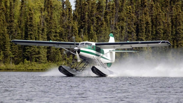 float plane landing on water on ultimate alaska adventure trip