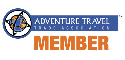 Adventure Travel Trade Association Member logo with globe on axis graphic