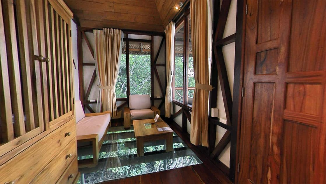 The glass floor inside the living room of the Panoramic Suite lets guests view wildlife below, at the Napo Wildlife Center, a luxury eco lodge surrounded by a rainforest biosphere reserve in the Ecuadorian Amazon.
