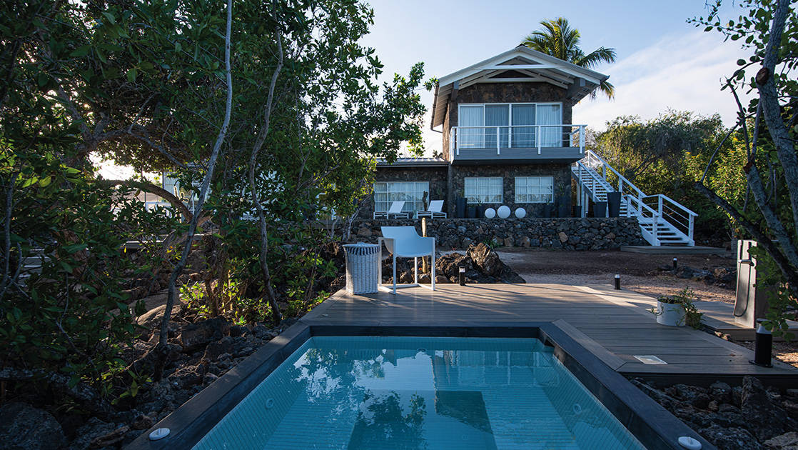 Exterior of spa with hot tub and chaise loungers on deck at Finch Bay Eco Hotel on Santa Cruz Island in the Galapagos.