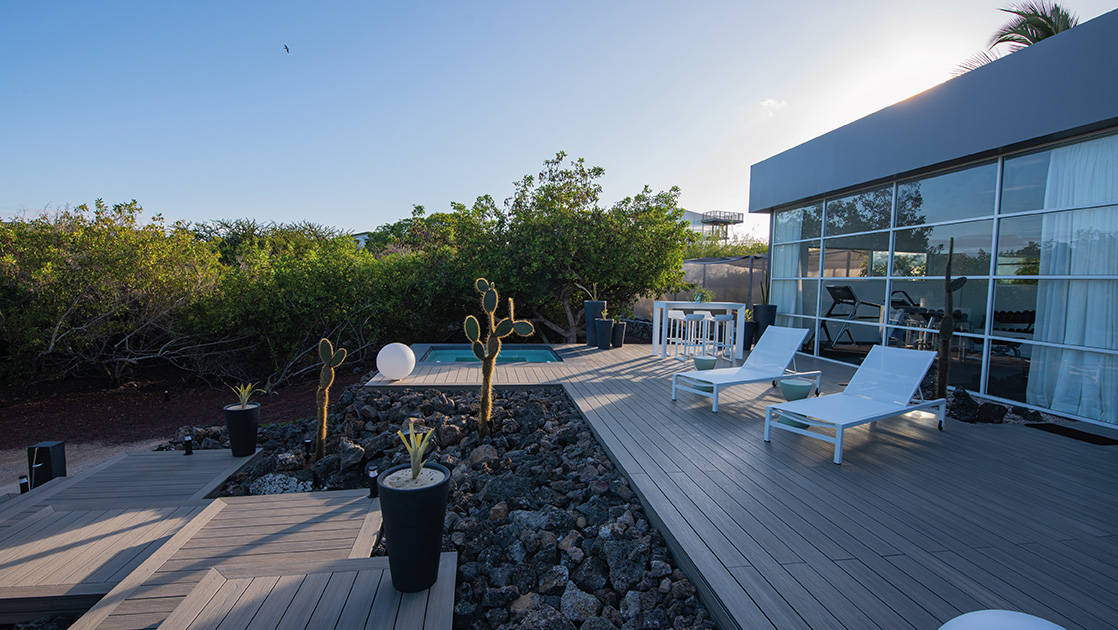 Exterior of spa with hot tub, cacti and chaise loungers on deck at Finch Bay Eco Hotel on Santa Cruz Island in the Galapagos.