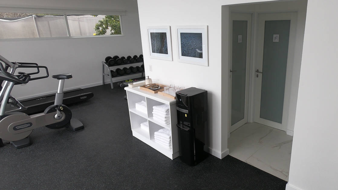 Spa gym with with indoor bicycle and free weights at Finch Bay Eco Hotel on Santa Cruz Island in the Galapagos.
