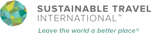 Sustainable Travel International logo with abstract earth globe graphic and Leave the world a better place motto.
