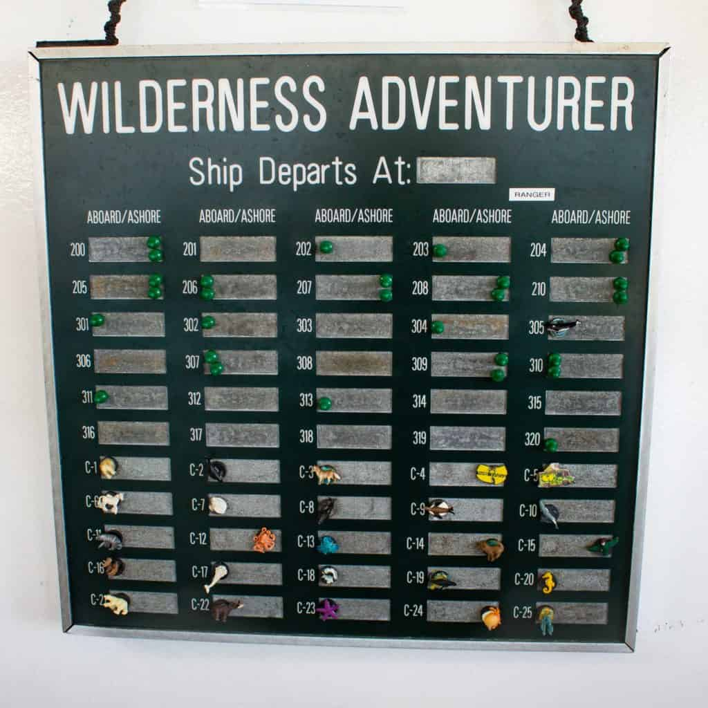 A magnetic board with cabin number magnets on the Wilderness Adventurer used to with our room number to alert the staff if guests were aboard or on shore.
