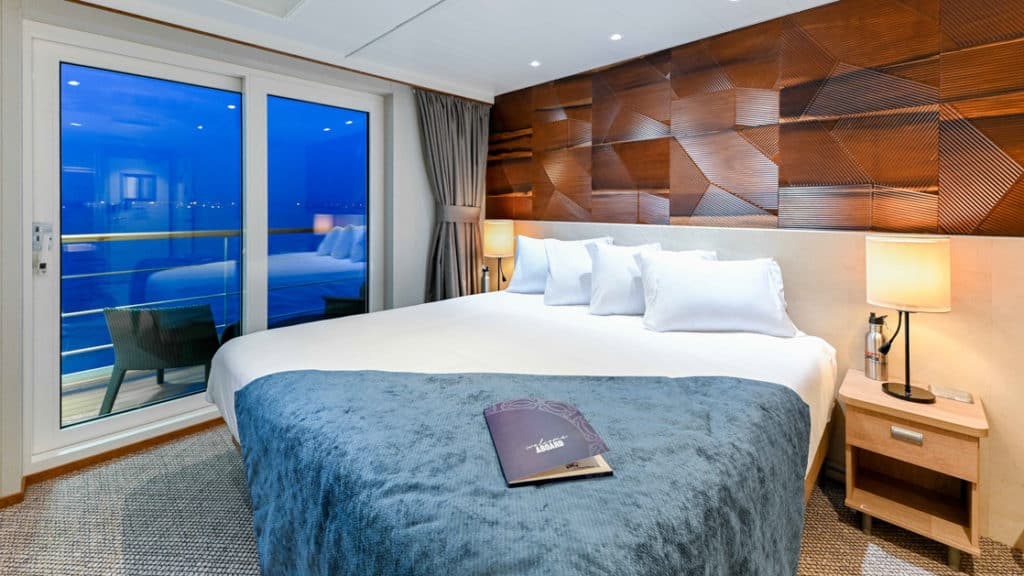 Bridge Deck Stateroom with junior king bed aboard Coral Geographer