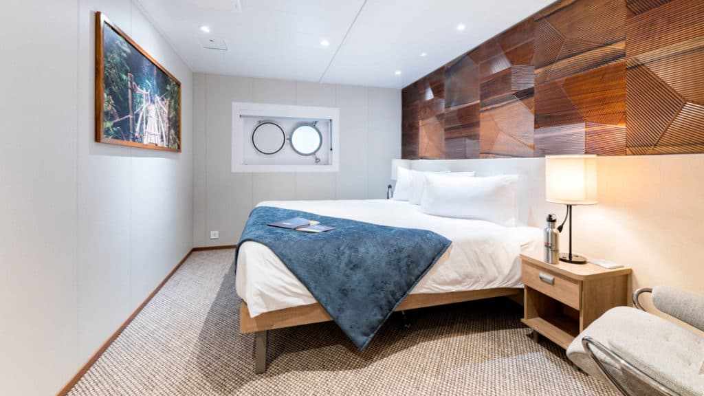 Coral Deck Stateroom with junior king bed aboard Coral Geographer