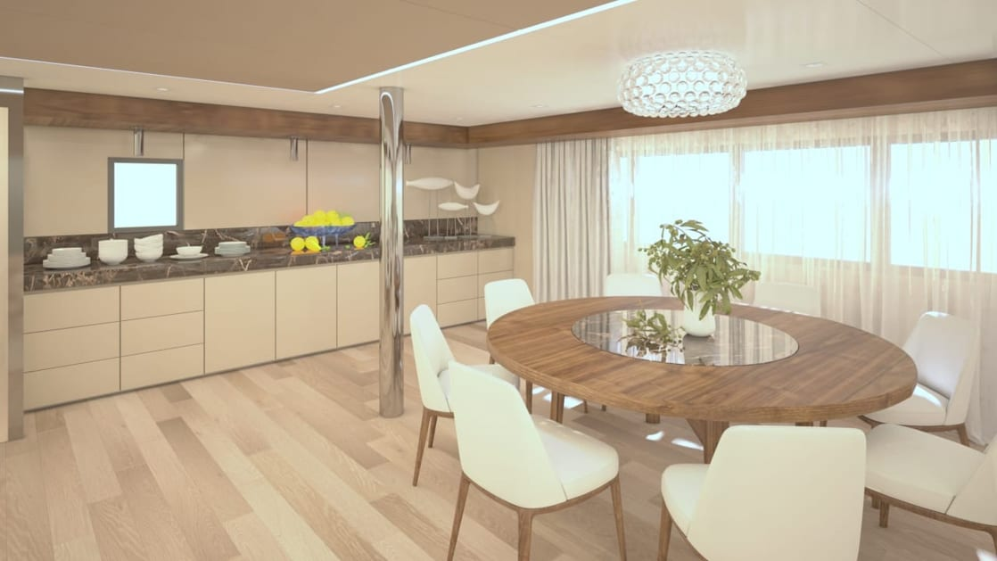 Rendering of deluxe Mediterranean yacht Adriatic Sky, showing Dining Room with round wooden table surrounded by white chairs, buffet bar with plates & bowls, sun-filled windows shaded by floorlength curtains, wooden flooring and tan-and-marble accents.