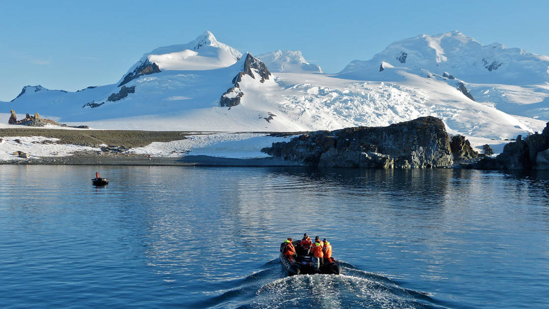Polar travelers head to shore in a Zodiac on the Antarctic Southern Latitudes voyage.