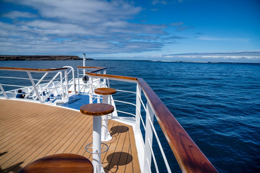 A clear blue day in the Galapagos Islands the back stern of the La Pinta Small ship showing the outdoor bar and observation lounge