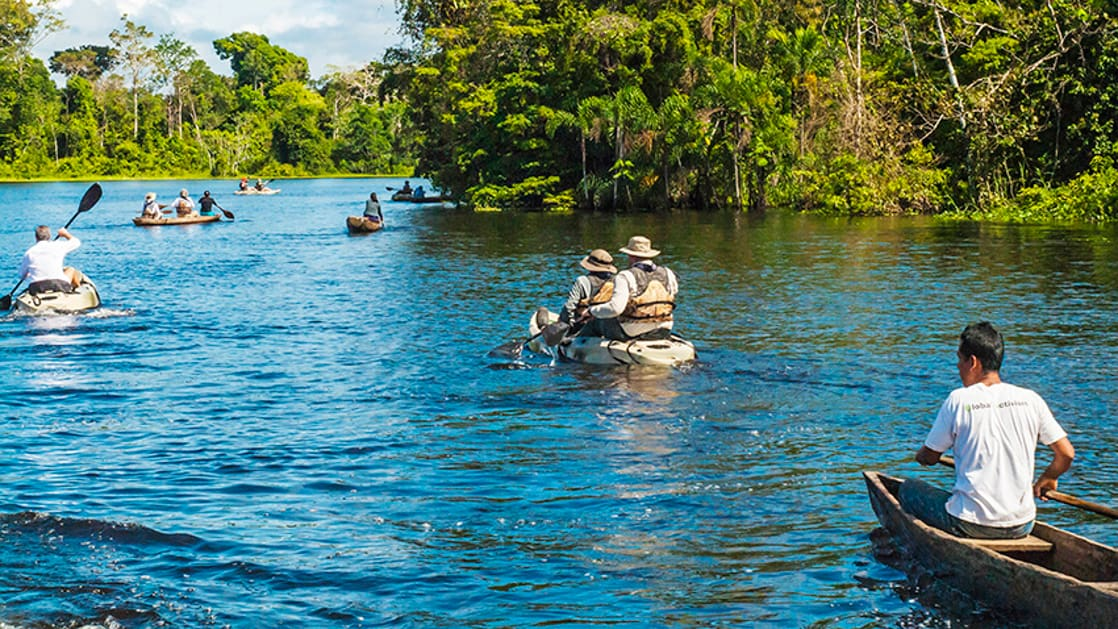 Two people kayaking on river in the Peruvian Amazon
