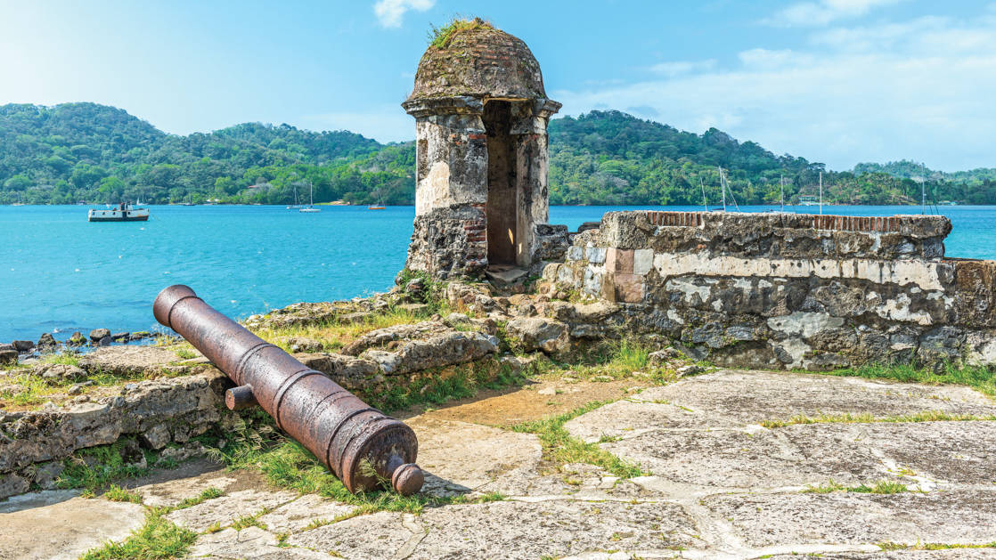 Old Spanish cannon at the fortress ruin of Santiago with a view over the Caribbean Sea in Portobelo near Colon, Panama.