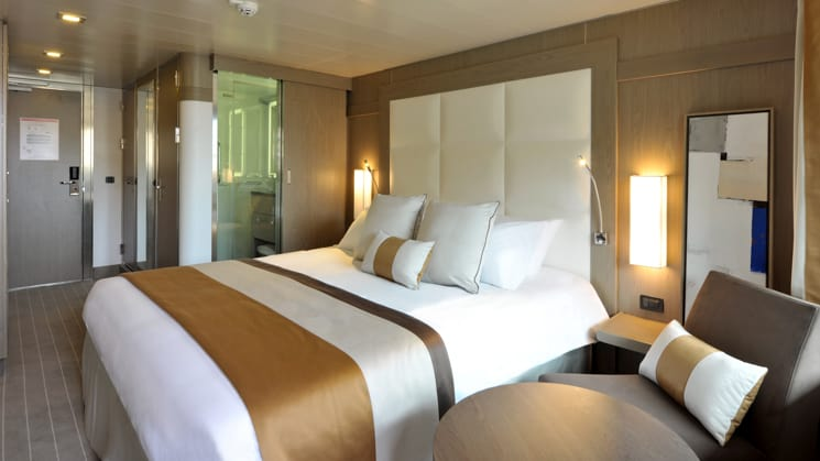 Deluxe Stateroom with king bed aboard L'Austral. Photo by: Francois Lefebvre/Ponant