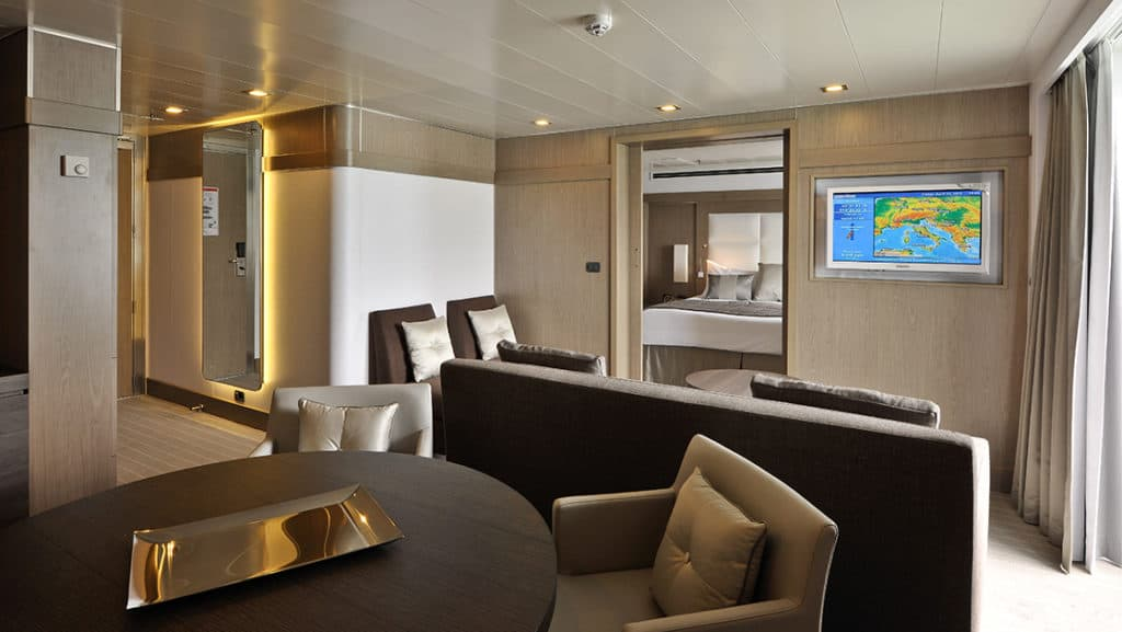 Owner's Suite with king bed aboard L'Austral. Photo by: Francois Lefebvre/Ponant